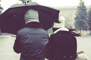 Couple-walking-umbrella