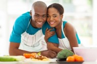 21512965 - cute african american couple in home kitchen