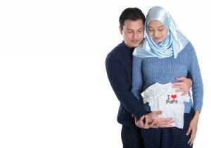 51185246 - young happy muslim pregnant couple over white background