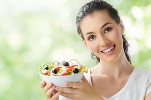 15187984 - a beautiful girl eating healthy food