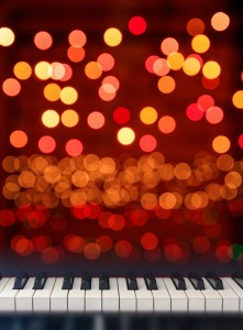 Piano keyboard front view on lights bokeh background